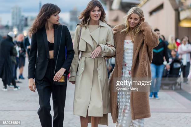 Model Georgia Fowler model Montana Cox and Elyse Taylor wearing a trench coat outside Dion Lee during MercedesBenz Fashion Week Resort 18 Collections...