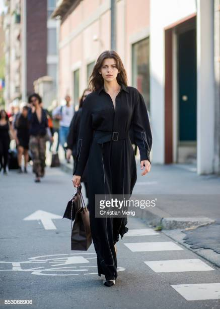 Model Georgia Fowler wearing a black overall is seen outside Trussardi during Milan Fashion Week Spring/Summer 2018 on September 24 2017 in Milan...