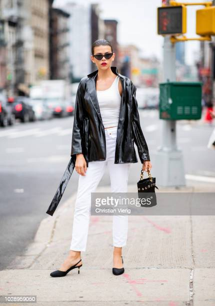 Model Georgia Fowler wearing black leather jacket white pants and top seen outside Cushnie et Ochs during New York Fashion Week Spring/Summer 2019 on...