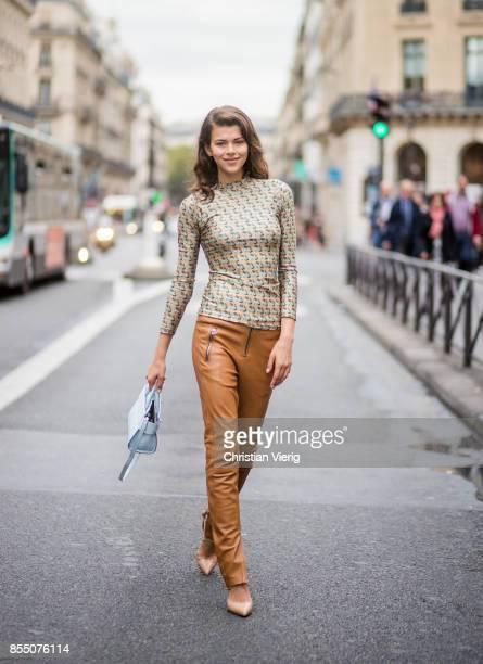 Model Georgia Fowler wearing brown pants is seen outside Balmain during Paris Fashion Week Spring/Summer 2018 on September 28 2017 in Paris France