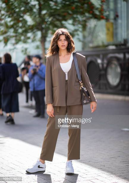 Model Georgia Fowler wearing brown suit cropped top is seen outside Roland Mouret during London Fashion Week September 2018 on September 16 2018 in...