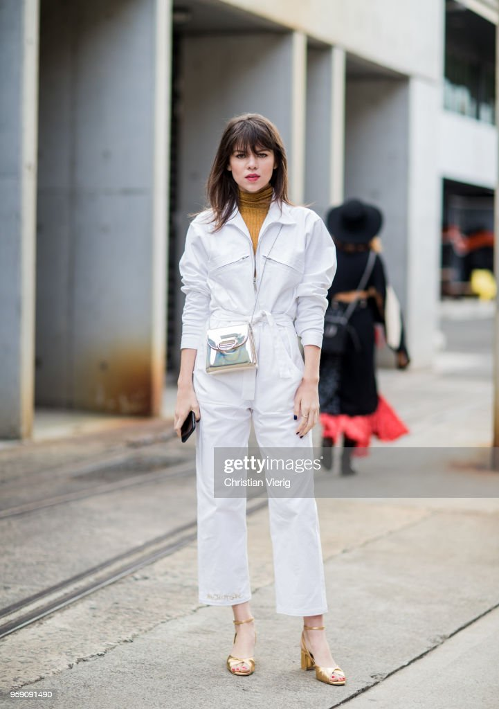 Model Georgia Fowler wearing white overall during Mercedes-Benz Fashion Week Resort 19 Collections at Carriageworks on May 16, 2018 in Sydney, Australia.
