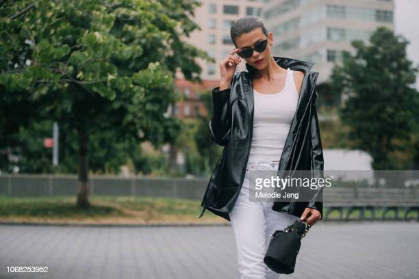 Model Georgia Fowler wears a black and white outfit after the Cushnie show during New York Fashion Week Spring/Summer 2019 on September 7 2018 in New...