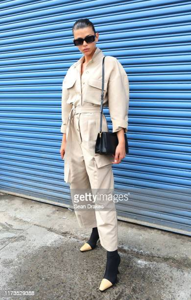 Model Georgia Fowler wears a khaki jumpsuit after walking in the Laquan Smith show during New York Fashion Week at Pier 59 on September 8, 2019 in...