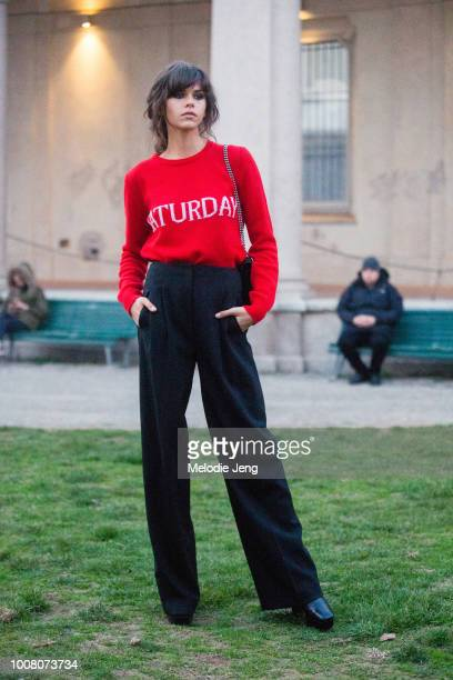 Model Georgia Fowler wears an Alberta Ferretti Saturday red sweater tucked into black after the Ferretti show during Milan Fashion Week Fall/Winter...