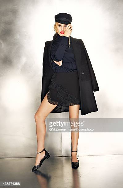Model Georgia May Jagger is photographed for Madame Figaro on June 20, 2014 in Paris, France. Coat , sweater and skirt , vintage cap, earrings , ring...