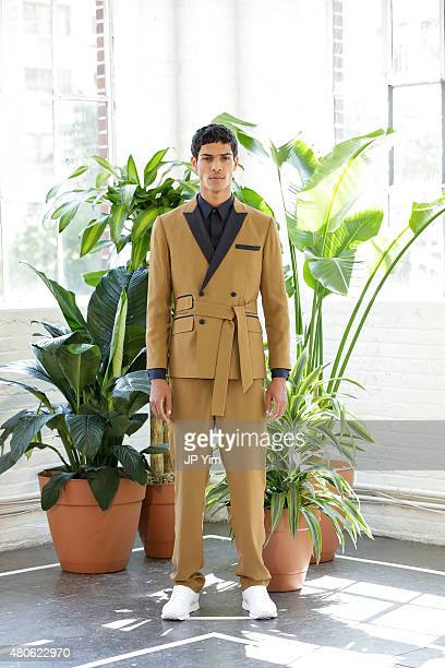 Model Geron McKinley poses at the Carlos Campos Spring/Summer 2016 Presentation during New York Fashion Week: Men's S/S 2016 at Industria Superstudio...