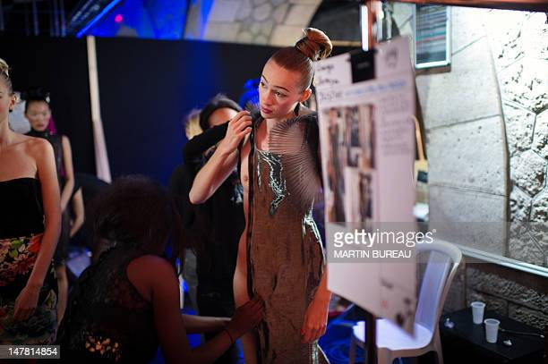 Model gets dressed in the backstage of French designer Julien Fournie's show during the Haute Couture Fall-Winter 2012-2013 collections presentations...