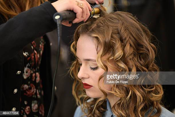 A model gets her hair done backstage ahead of the Blugirl show during the Milan Fashion Week Autumn/Winter 2015 on February 26 2015 in Milan Italy
