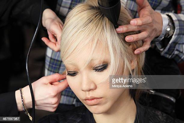 A model gets her hair done backstage at Peter Som MADE Fashion Week Fall 2014 at Milk Studios on February 7 2014 in New York City
