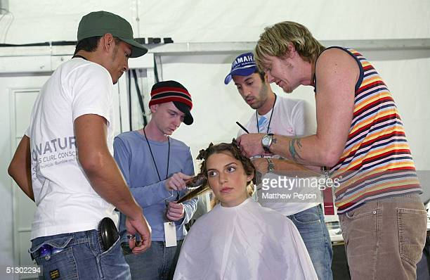 A model gets her hair done backstage at the Rebecca Taylor Couture Spring 2005 fashion show during the Olympus Fashion Week Spring 2005 at the Plaza...
