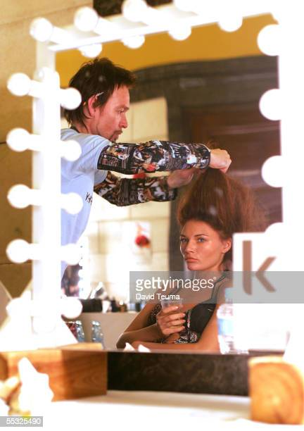 A model gets her hair fixed backstage in preparation to New Order fashion show during Motorola Melbourne Spring Fashion Week at the Melbourne Town...