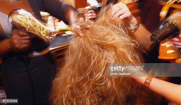 A model gets her hair styled backstage at the Elspeth Gibson fashion show as part of London Fashion Week Spring/Summer 2005 at Kent House on...