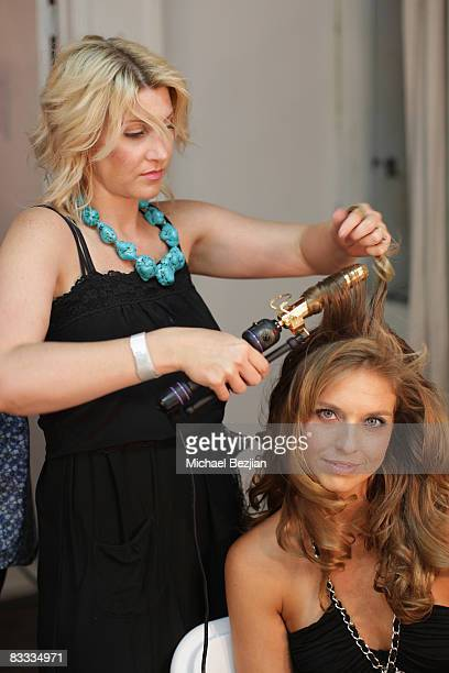 Model gets her hair styled backstage during the Yotam Solomon Spring-Summer 2009 Runway Show at Box Eight on October 17, 2008 in Los Angeles,...