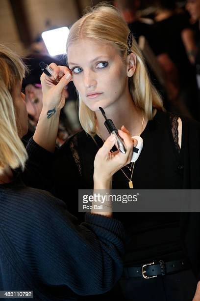 A model gets her make up done backstage ahead of the Lovechild 1979 show during the first day of Copenhagen Fashion Week Spring/Summer 2016 on August...