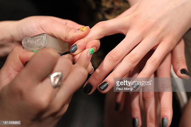 Model gets her nails done backstage at ICB By Prabal Gurung during Fall 2013 Mercedes-Benz Fashion Week at The Studio at Lincoln Center on February...