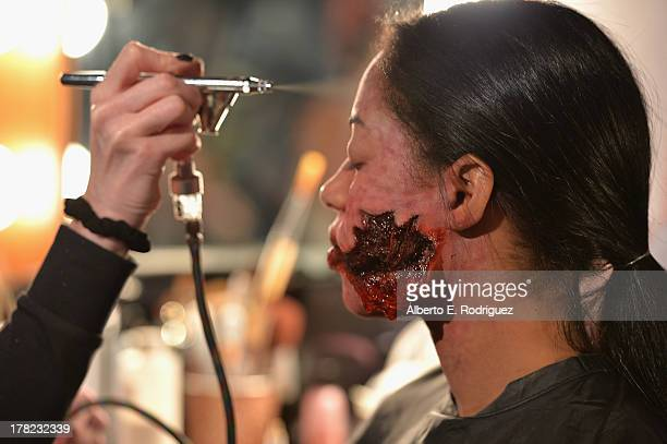 A model gets made up as a zombie at Universal Studios' Halloween Horror Nights media makeup kickoff at The Globe Theatre on August 27 2013 in...