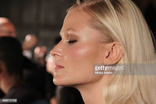 A model gets makeup applied backstage at the Sass Bide fashion show during MercedesBenz Fashion Week Fall 2014 at The Waterfront on February 12 2014...