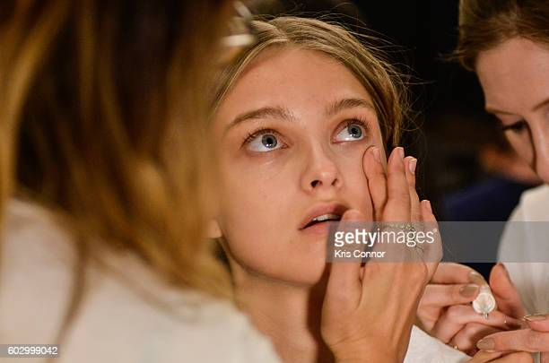 A model gets makeup done backstage during the Jenny Packham fashion show during new York Fashion Week September 2016 at Skylight at Moynihan Station...