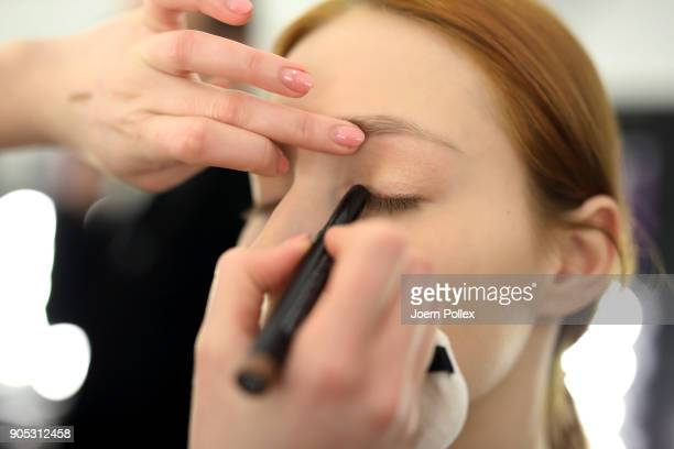 A model gets prepared ahead of the Dawid Tomaszewski show during the MBFW January 2018 at ewerk on January 15 2018 in Berlin Germany