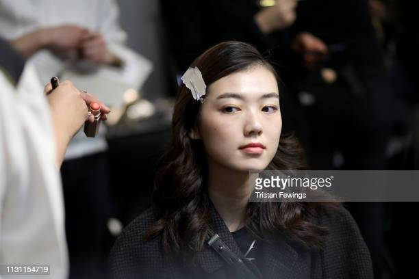 A model gets prepared backstage ahead of the Anteprima show at Milan Fashion Week Autumn/Winter 2019/20 on February 21 2019 in Milan Italy