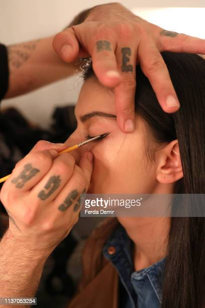 A model gets prepared backstage ahead the Ozlem Kaya show during MercedesBenz Istanbul Fashion Week at the Zorlu Performance Hall on March 20 2019 in...