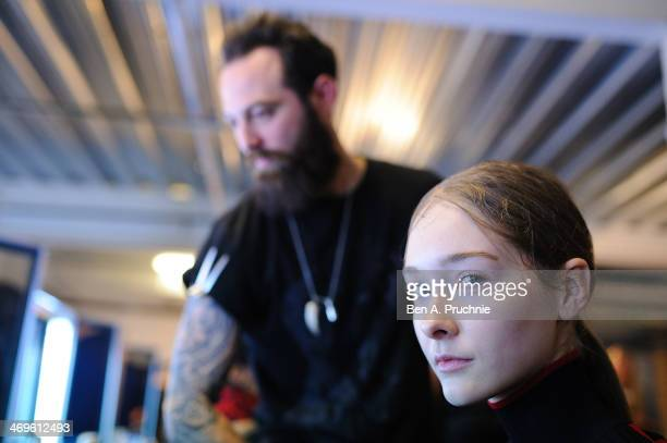 A model gets prepared backstage at the Hunter Original show at London Fashion Week AW14 at University of Westminster on February 15 2014 in London...