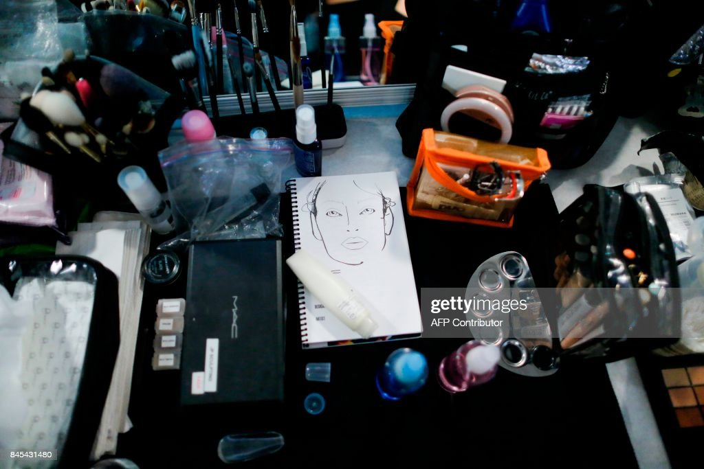 A model gets ready at backstage before the Prabal Gurung SS18 show during New York Fashion Week on September 10, 2017 in New York. /
