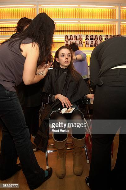 A model gets ready at the Adam Eve Fall 2006 presentation during Olympus Fashion Week at Buddankan February 6 2006 in New York City