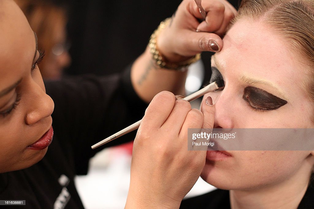 A model gets ready backstage at Falguni & Shane Peacock during Fall 2013 Mercedes-Benz Fashion Week at The Studio at Lincoln Center on February 13, 2013 in New York City.