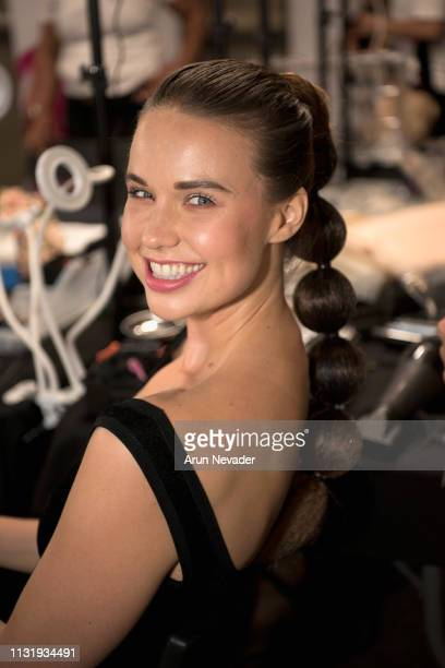 A model gets ready backstage at Los Angeles Fashion Week FW/19 Powered by Art Hearts Fashion at The Majestic Downtown on March 21 2019 in Los Angeles...