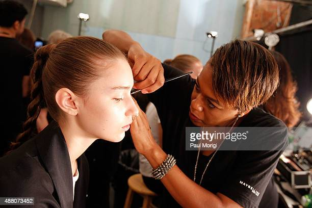 A model gets ready backstage at Public School Spring 2016 during New York Fashion Week The Shows at The Arc Skylight at Moynihan Station on September...