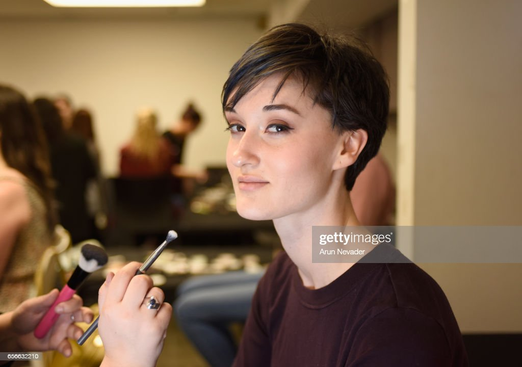 A model gets ready backstage at Vancouver Fashion Week Fall/Winter 2017 at Chinese Cultural Centre of Greater Vancouver on March 22, 2017 in Vancouver, Canada.