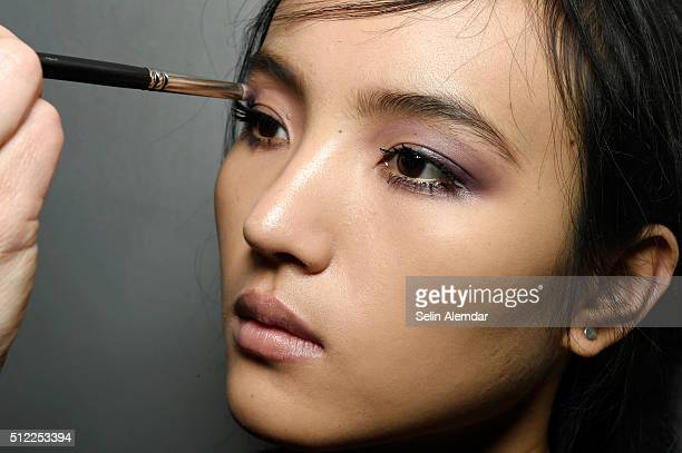 A model gets ready beauty detail backstage ahead of the Les Copains show during Milan Fashion Week Fall/Winter 2016/17 on February 25 2016 in Milan...