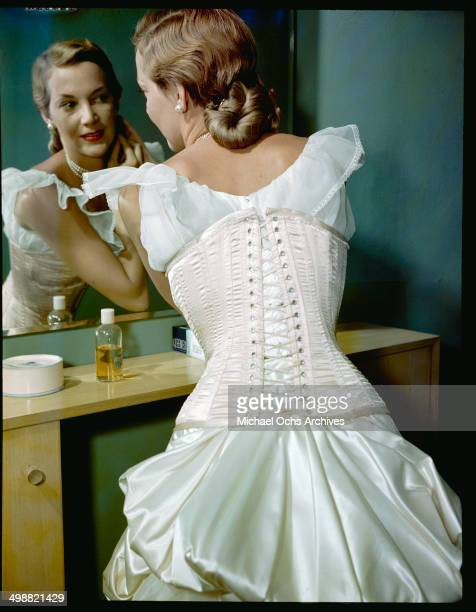 A model gets ready dressed in a lingerie corset in New York in September 271949