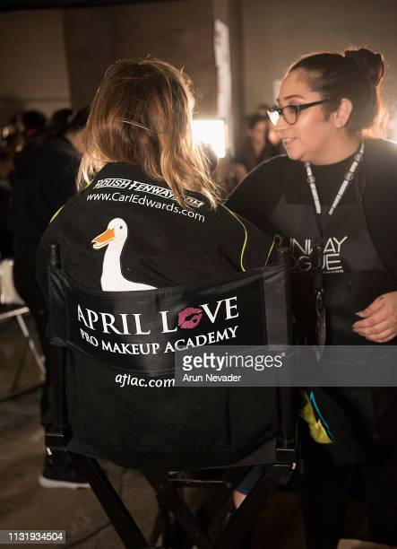 A model gets ready with April Love backstage at Los Angeles Fashion Week FW/19 Powered by Art Hearts Fashion at The Majestic Downtown on March 21...