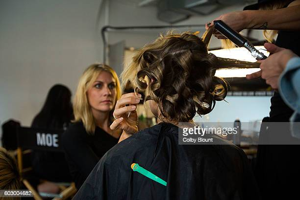A model gets their hair done backstage at the Pyer Moss fashion show during MADE Fashion Week September 2016 at Milk Studios on September 11 2016 in...
