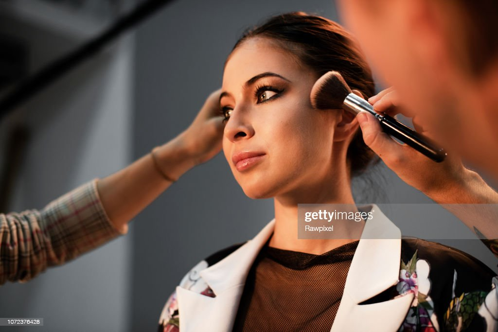 Model getting a touch up : Stock Photo