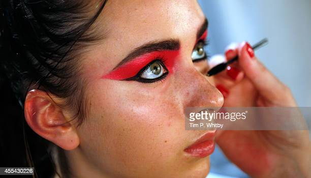 Model getting make up applied backstage at the Ashley Williams show during London Fashion Week Spring Summer 2015 at TopShop Show Space on September...