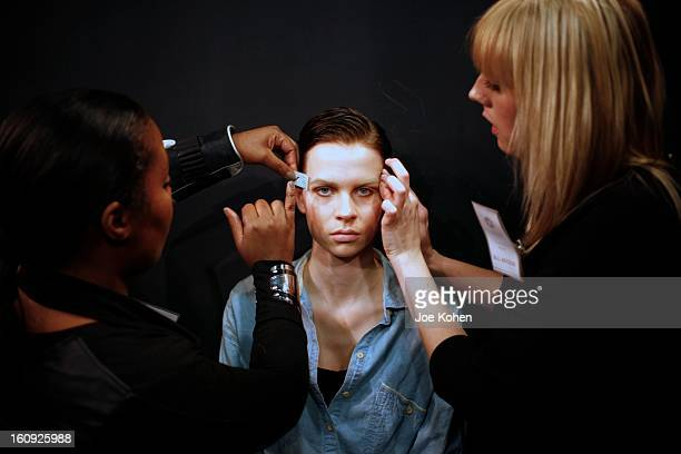 A model getting ready backstage at the Sukeina fall 2013 fashion show during MercedesBenz Fashion Week at Helen Mills Event Space on February 7 2013...
