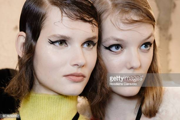 Model Giedre Dukauskaite and a model are seen backstage ahead of the N21 show during Milan Fashion Week Fall/Winter 2018/19 on February 21 2018 in...