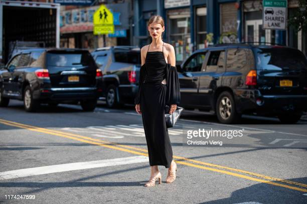 Model Giedre Dukauskaite is seen wearing black dress bag heels outside Dion Lee during New York Fashion Week September 2019 on September 11 2019 in...