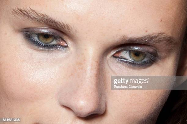 Model Giedre Dukauskaite make up detail is seen ahead of the backstage Sportmax show during Milan Fashion Week Spring/Summer 2018 on September 22...