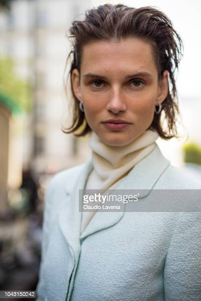 Model Giedre Dukauskaite wearing a white turtleneck sweater and light blue blazer is seen after the Altuzarra show on September 29 2018 in Paris...