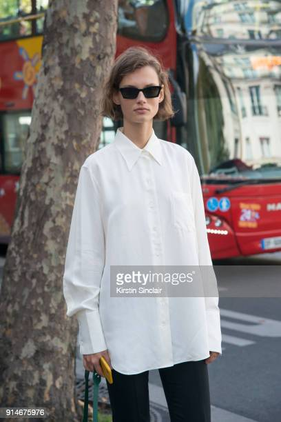 Model Giedre Dukauskaite wears a Celine shirt and OffWhite sunglasses day 5 of Paris Womens Fashion Week Spring/Summer 2018 on September 30 2017 in...
