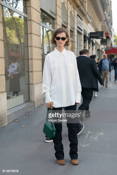 Model Giedre Dukauskaite wears a Celine shirt OffWhite bag and sunglasses and Saint Laurent shoes day 5 of Paris Womens Fashion Week Spring/Summer...