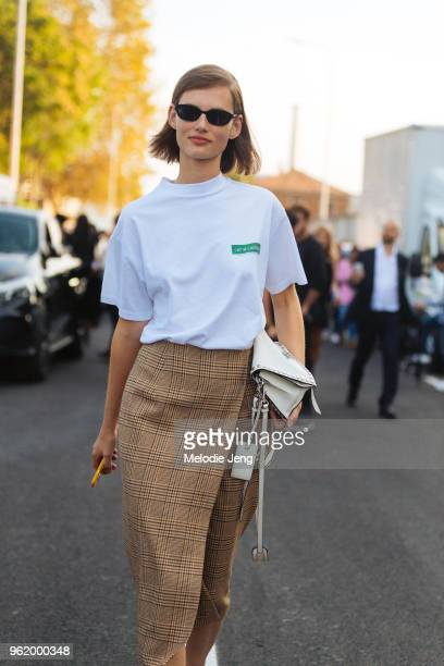 Model Giedre Dukauskaite wears a L'Art de L'automobile shirt plaid skirt during Milan Fashion Week Spring/Summer 2018 on September 23 2017 in Milan...