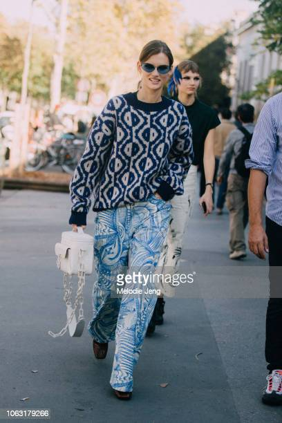 Model Giedre Dukauskaite weasrs blue sunglasses and print on print after the Dries Van Noten show during Paris Fashion Week Spring/Summer 2019 on...