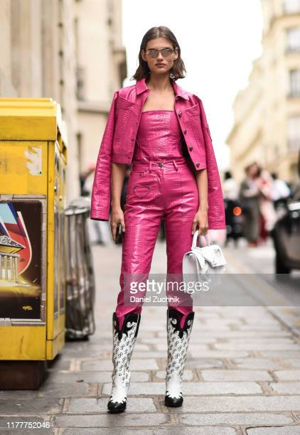 Model Gierdre Dukauskaite is seen wearing a pink Saks Potts outfit with an Off White bag outside the Altuzarra show during Paris Fashion Week SS20 on...