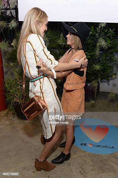 Model Gigi Hadid and actress Sarah Hyland attend the Official HM Loves Coachella Party at the Parker Palm Springs on April 10 2015 in Palm Springs...